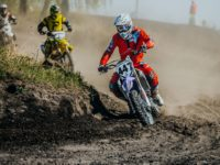 Miasskoe Russia - May 02 2016: group racer on a motorcycle turns on a dusty race track during Cup of Urals motocross